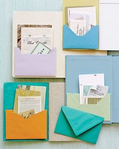 Make a favorite notebook or journal an organized repository for notes and papers, business cards, and receipts by giving it a built-in pocket. Fold back the flap of a colorful envelope from a greeting card and moisten the glue strip with water. Position it on the inside of the notebook's cover, and press to attach. Secure the envelope's bottom corners with double-sided tape. Other desk organizing ideas here and I did like a few of them. I adore the colors used. #officesecuritytips