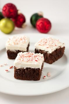 Peppermint brownies with peppermint butter cream frosting. These look delicious!