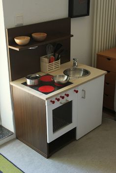 Materials: Valla kitchen doors, S�tta handle, Placemat (black and red) Description: I planned to make a play-kitchen for my daughter and searched for some insp