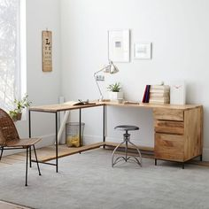 Stylish storage. Crafted from solid mango wood and lofted on airy steel legs, our Rustic Modular Desk features two separate work surfaces and a bottom shelf to prop your feet up on. The attached box file keeps papers and supplies organized and out of the way.