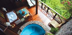 """""""A view with a room"""" - Ladera Resort, St. Lucia, where each room is designed without a 4th wall so guests can look out at the sea and Piton Mountains"""