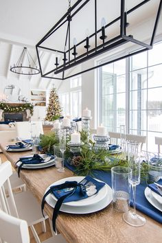 Silver and Navy Christmas Table Setting is part of Navy Living Room Christmas - Silver and navy Christmas table setting Navy tablecloth and napkins, glass candle holders, green garland and silver touches Classy Christmas, Coastal Christmas, Beautiful Christmas, Christmas Home, Modern Christmas, Christmas Trees, Cottage Christmas, Purple Christmas, Nordic Christmas