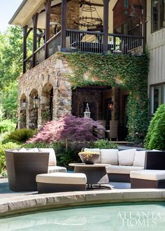 Two stories of covered terraces plus poolside seating accommodate overflow guests when the homeowners host parties. Two stories of covered terraces plus poolside seating accommodate overflow guests when the homeowners host parties. Outdoor Rooms, Outdoor Living, Outdoor Seating, Atlanta Homes, Stone Houses, Backyard Patio, Backyard Landscaping, Pergola Patio, Stone Landscaping