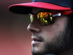reporters are reflected in the glasses of St. Louis Cardinals pitcher Joe Kelly before Game 4 of baseball's World Series against the Boston Red Sox Sunday, Oct. 27, 2013, in St. Louis. (AP Photo/Jeff Roberson)