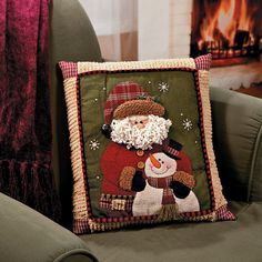 I have this and I love to decorate my space with it.  Santa & Snowman Pillow - TerrysVillage.com
