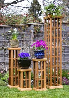 Trellis column 20 inch garden decor will distinguish your landscaping with style and stature. The Arboria Trellis Column serves perfectly as a trellis for climbing plants, as a pedestal for display or as a decorative plant stand. Garden Arbor, Garden Trellis, Garden Planters, Wood Trellis, Outdoor Projects, Garden Projects, Garden Seating, Yard Design, Garden Structures