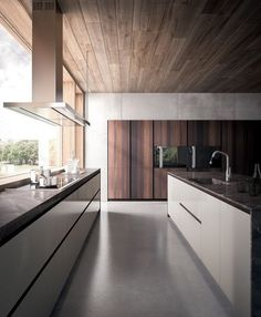 Love the big window behind the kitchen and the timber roof