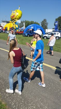 Daniel Bordovský catched with a girl and helium baloon. The are probably on some entertaining event.
