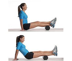 Foam roller release for calf and Achilles area. Crossing one leg over the other increases massage pressure on the rolling leg compared to doing both legs on the roller at the same time. This can be used as a progression as tolerated.