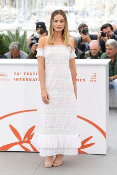 """""""Once Upon A Time In Hollywood"""" Photocall - The Annual Cannes Film Festival - Margot Robbie in an off-the-shoulder white Chanel dress Margot Robbie Style, Margot Elise Robbie, Morgot Robbie, Tilda Swinton, Dior Haute Couture, Elle Fanning, Formal Dress Shops, Formal Dresses, Selena Gomez"""