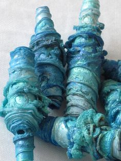 Mixed media textile art beads hand made with Tyvek - shimmering turquoise, aqua, ocean blue and sea green by Carolyn Saxby Textiles Paper Bead Jewelry, Textile Jewelry, Fabric Jewelry, Paper Beads, Jewelry Art, Jewlery, Carolyn Saxby, Creative Textiles, Fabric Beads