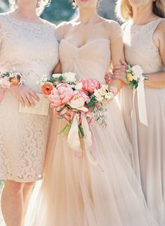 A bride in blush Reem Acra poses with mature attendants wearing buff. #Weddings