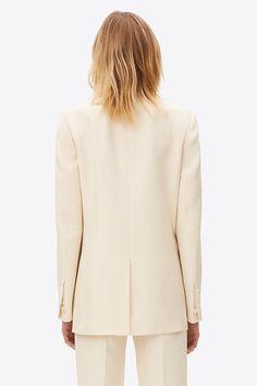 An elongated silk jacket with a shawl collar.