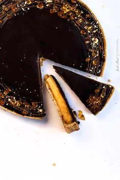caramel tart topped with chocolate ganache and gelatine candy