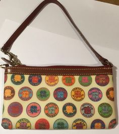 Dooney & Bourke Baguette Mini Barrel Wristlet Handbag Circle Signature Small EUC  | eBay