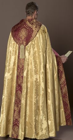 Beatissima Cope HOLY ROOD Silk Barocco damask in pale gold. St. Andrew's cross of gold on garnet San Carlo damask. Small gold galloon.