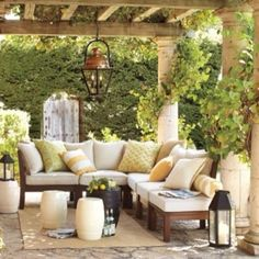 Great patio, grape vines or wisteria above..love this, i want one of the two wrapped around my future deck