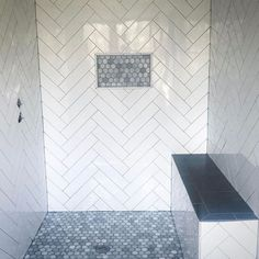 Herringbone subway tile with grey grout. Hexagon marble floor and shower niche. Proof a wimpy in size shower niche is the wrong choice when the tile in the niche is a focal point. Master Shower Tile, Gray Shower Tile, Subway Tile Showers, Shower Niche, Master Bathroom, Small Bathroom, Bathroom Ideas, Bathroom Showers, Subway Tiles