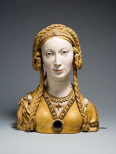 Reliquary Bust of a Female Saint Date: ca. 1520–30 Geography: Made in possibly Brussels, Belgium Culture: South Netherlandish Medium: Oak, paint, gilt Dimensions: Overall: 16 11/16 x 12 3/4 x 6 1/4 in. (42.4 x 32.4 x 15.9 cm) Classification: Sculpture-Wood Credit Line: The Cloisters Collection, 1959 Accession Number: 59.70