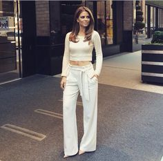 Maria Menounos - white flared pants + cropped sweater