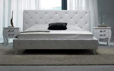 Tufted white leather all around the bed crystals on headboard. Leatherette wrapped bed frame and headboard gives it an extraordinary look. For those who prefer even more glamour, this gorgeous bed is also available with crystals and in black leatherette as well. To add even more elegance, pair this ...