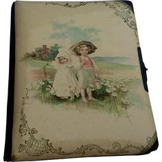 The celluloid photo  album features a smooth cream colored cover with two children in a field of daisies. Description from rubylane.com. I searched for this on bing.com/images
