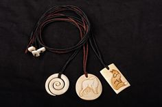 Triple Spiral, Bolshoi Borzoi, and a Fox. Beefbone, stained. #bonecarving #pendant #fox