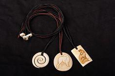 Triple Spiral, Bolshoi Borzoi, and a Fox. Beefbone, stained. #bonecarving #pendant #fox