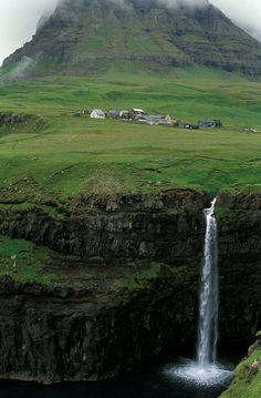 Gásadalur Waterfall in the village of Gásadalur in the Faroe Islands. The Faroe Islands are an island group under the sovereignty of the Kingdom of Denmark, approximately halfway between Norway and Iceland. Places Around The World, Oh The Places You'll Go, Places To Travel, Places To Visit, Around The Worlds, Travel Destinations, Les Cascades, Adventure Is Out There, Dream Vacations