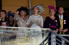 He's done it! Sophie, who was wearing a hat by milliner Jane Taylor, screams for joy in he...