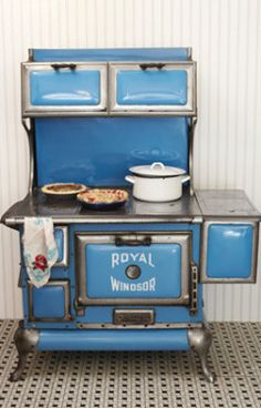 Stove from the 20s... Grandma Edna's stove had the water heater on the left side of the stove and was a lighter blue & white.