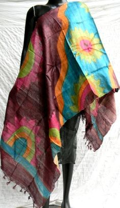 This beautiful handwoven tussar silk stole/dupatta has been brush painted in bold nature patterns and vibrant colors