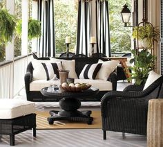 black and white porch seating and outdoor curtains