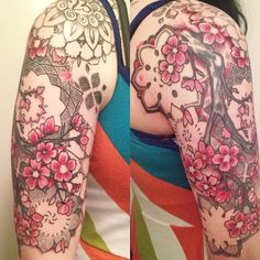 It started with the mandala on my shoulder, the 23 for my favorite song 23 by Jimmy Eat World. The cherry blossoms came on Leap Day 2012. The background detail and additional mandalas took 3 sessions and were my artists idea. All work done by Jason Saint at Mercy Seat Tattoo in Kansas City, Missouri. Im completely in love with it.