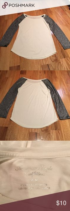 White, sparkly sleeve 3/4 length top White top with sparkly 3/4 length sleeves -Excellent condition/like new  (only worn a couple times) -size medium --------------------------------------- -will negotiate  -If you have any questions just ask me American Eagle Outfitters Tops Blouses