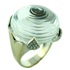 Rock Crystal and Diamond Ring in 18K White Gold by David Webb, 1980s. The mounting is 18K White Gold. On the four corners this ring boast .80 carats of diamonds. The Center is crafted out of Rock Crystal in a progressive series of rings.
