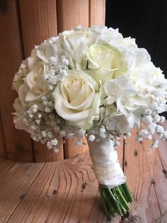 Ivory rose and gypsophelia bridal bouquet including hydrangea and pearls. This style bouquet can be made to your colour, roses are available in almost every colour and tone with varied shapes and size heads.
