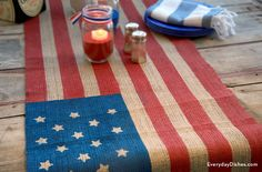 Get patriotic with this DIY table runner. It's easy to make using tape, paint and stickers.