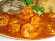 Shrimp a la Diabla       2 Guajillo chile peppers, 5 Arbol chile peppers,5 Serrano chile peppers,1 28-oz Can tomato puree,1 Stick of butter,1 Medium onion, finely chopped,1/2 Head of garlic, minced, 2 Lbs prawns, peeled and de-veined, tail intact.Salt to taste