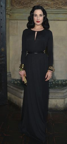 DITA VON TEESE, looking very chic in a black jersey gown with an array of bracelets.