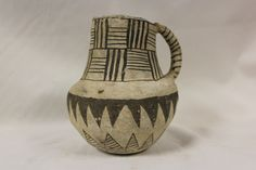 Anasazi Pottery 269. Description: a very nice and intact Anasazi black on white Snowflake pitcher with painted basket weave design around neck. Remains in as fo