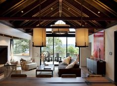 By SB Architects.  The warmth of the dark wood enhance this room tremendously and add as sense of occasion to the minimalist ceiling light fixtures.  Watch the how the rhythm of the rafters interacts with the tension ties.