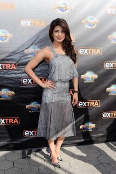 Priyanka Chopra's 'Quantico' Premieres to Solid Ratings.  Priyanka Chopra poses for pictures while making an appearance on Extra on Monday (September 28) at Universal Studios in Los Angeles.