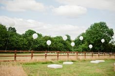 Balloons on fence perfection  Image by Dominique Bader.