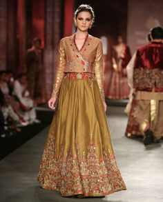 Buy Olive Green Lengha Set with Angarakha Blouse By Anju Modi online in India at best price. Olive green dupian pleated lengha with embroidered design. The set also includes gold chanderi prin India Fashion, Ethnic Fashion, Trendy Fashion, Latest Fashion, Women's Fashion, Indian Dresses, Indian Outfits, Indian Clothes, Choli Dress