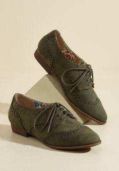 Walking on Wingtip-Toes Oxford Flat | Mod Retro Vintage Flats | ModCloth.com  Waltz, skip, shuffle, or slide down the sidewalk in these olive green Oxfords - whatever makes you happy! With perforated wingtips, a faux-suede finish, and the advantage of versatility, these Restricted flats are worth dancing about.