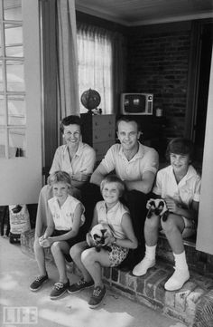 "When asked in 1991 about his wife's reaction to the nascent American space program of the 1950s, Shepard said, ""I think she knew immediately that I would volunteer for it."" Above: Shepard with his wife, Louise, his niece -- who lived with the family -- and his two daughters, at home in Virginia Beach, 1960."