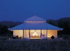 Aman I Khan India luxury tent exterior at night