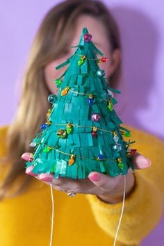 DIY Christmas Tree Party Hats // Turn a plain party hat into a fun holiday craft with tissue paper! Upcycle your hats into fringed Christmas trees decorated with lights and ornaments! How To Make Christmas Tree, Cute Christmas Gifts, Personalized Christmas Gifts, Christmas Gift Wrapping, Christmas Tree Decorations, Christmas Ornaments, Green Christmas, Xmas, Christmas Trends