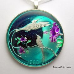 Hand painted coin from Jamaica with a Streamer tail Hummingbird. AnimalCoin.com, coin jewelry